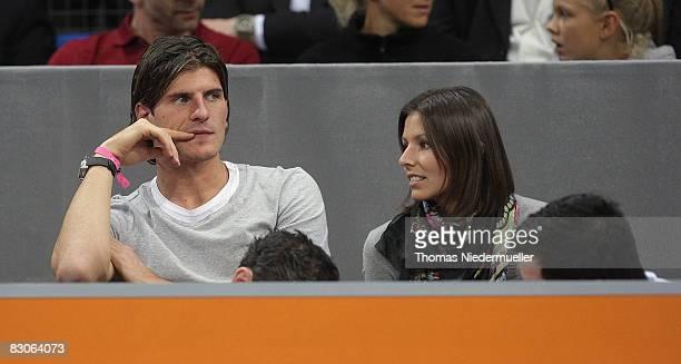 Mario Gomez of VfB Stuttgart is seen with his girlfriend Silvia Meichel during the Porsche Tennis Grand Prix at the Porsche Arena on September 30...