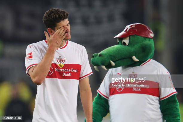 Mario Gomez of VfB Stuttgart looks dejected with Mascot Fritzle during the Bundesliga match between VfB Stuttgart and Eintracht Frankfurt at...
