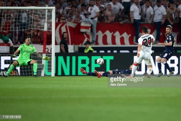 Mario Gomez of VfB Stuttgart scores his team's second goal during the Bundesliga playoff first leg match between VfB Stuttgart and 1 FC Union Berlin...
