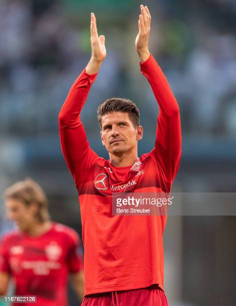 Mario Gomez of VfB Stuttgart waves to his fans after winning the DFB Cup first round match between Hansa Rostock and VfB Stuttgart at Ostseestadion...