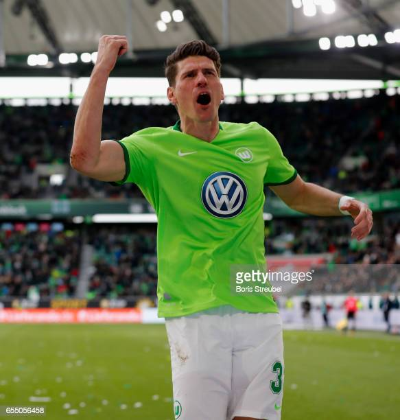 Mario Gomez of VfL Wolfsburg celebrates after scoring his team's first goal during the Bundesliga match between VfL Wolfsburg and SV Darmstadt 98 at...