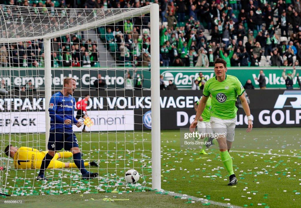Mario Gomez of VfL Wolfsburg celebrates after scoring his team's first goal during the Bundesliga match between VfL Wolfsburg and SV Darmstadt 98 at Volkswagen Arena on March 18, 2017 in Wolfsburg, Germany.