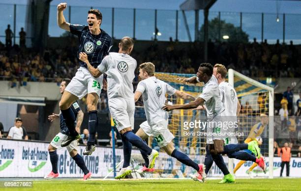 Mario Gomez of VfL Wolfsburg celebrates after Vieirinha of VfL Wolfsburg scores his team's first goal during the Bundesliga Playoff Leg 2 match...