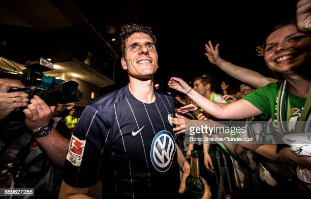 Mario Gomez of VfL Wolfsburg celebrates with the fans the continuance in the first Bundesliga after winning the Bundesliga Playoff Leg 2 match...
