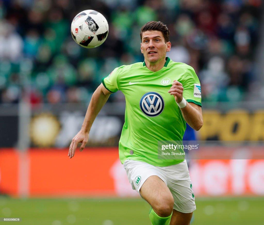 Mario Gomez of VfL Wolfsburg runs with the ball during the Bundesliga match between VfL Wolfsburg and SV Darmstadt 98 at Volkswagen Arena on March 18, 2017 in Wolfsburg, Germany.