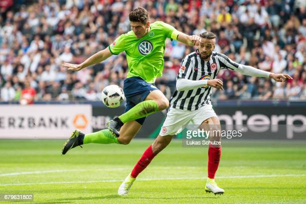 Mario Gomez of Wolfsburg and Michael Hector of Frankfurt fight for the ball during the Bundesliga match between Eintracht Frankfurt and VfL Wolfsburg...