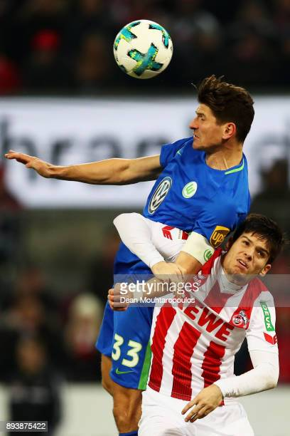 Mario Gomez of Wolfsburg battles for the ball with Jorge Mere of FC Koeln during the Bundesliga match between 1 FC Koeln and VfL Wolfsburg at...
