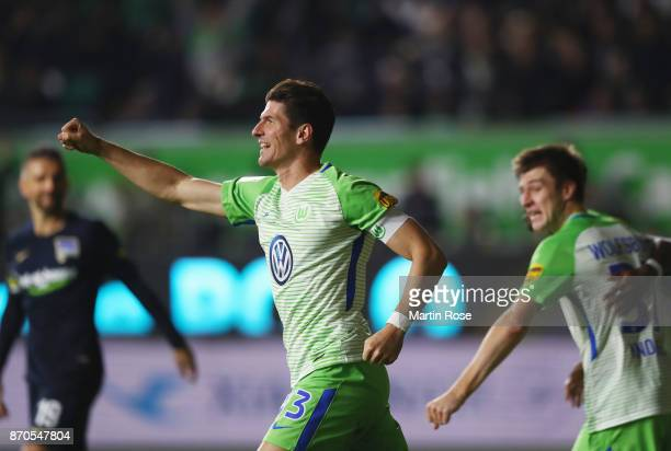 Mario Gomez of Wolfsburg celebrates a goal which is later disallowed following a video assistant referee decision during the Bundesliga match between...