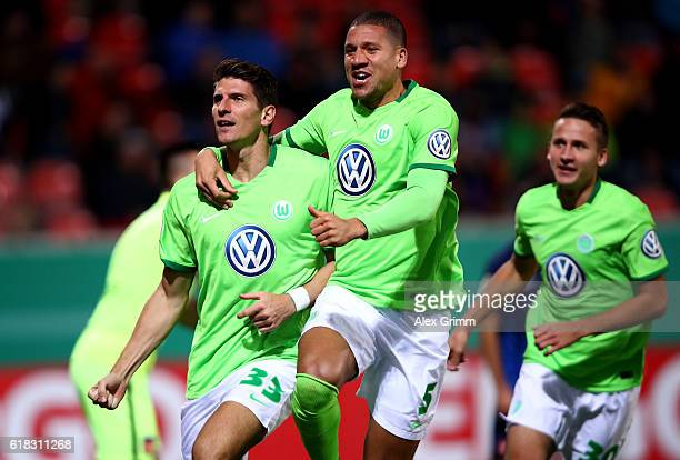 Mario Gomez of Wolfsburg celebrates after he scores the opening goal during the DFB Cup second round match between 1 FC Heidenheim and VfL Wolfsburg...