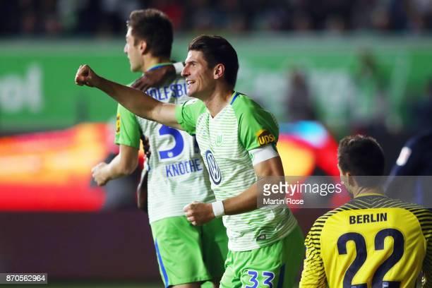 Mario Gomez of Wolfsburg celebrates his team's second goal during the Bundesliga match between VfL Wolfsburg and Hertha BSC at Volkswagen Arena on...