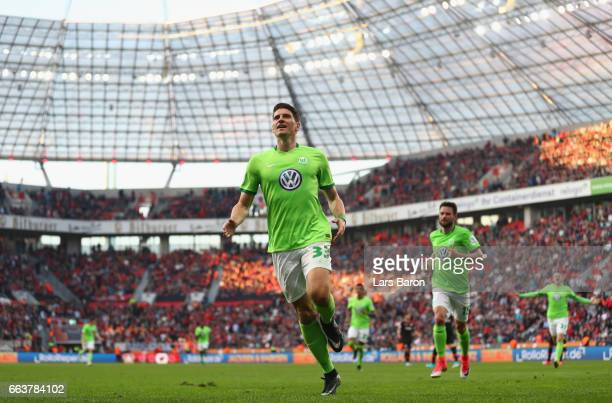 Mario Gomez of Wolfsburg celebrates scoring his third goal during the Bundesliga match between Bayer 04 Leverkusen and VfL Wolfsburg at BayArena on...