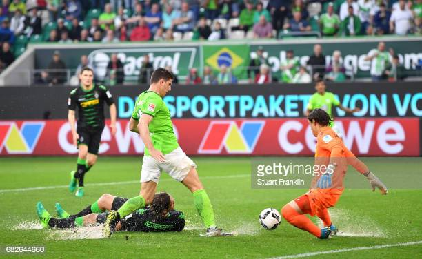 Mario Gomez of Wolfsburg has a chance stopped by Yann Sommer of Gladbach during the Bundesliga match between VfL Wolfsburg and Borussia...