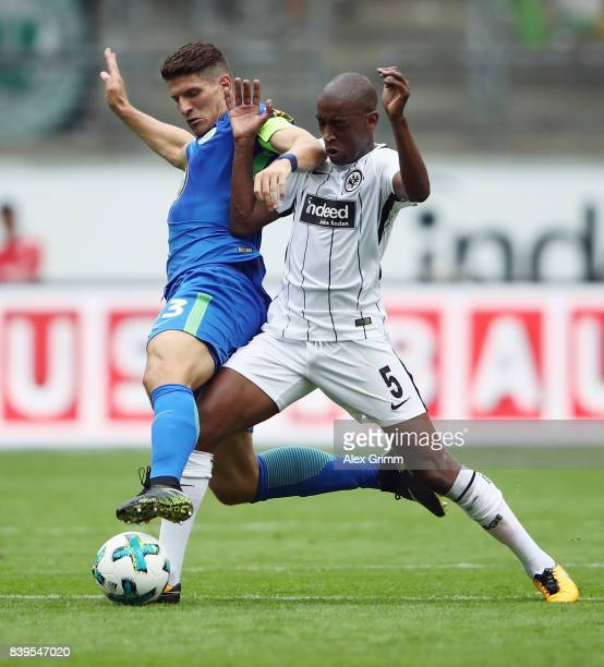 Mario Gomez of Wolfsburg is challenged by Gelson Fernandes of Frankfurt during the Bundesliga match between Eintracht Frankfurt and VfL Wolfsburg at...