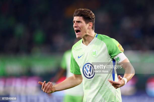 Mario Gomez of Wolfsburg reacts after his goal was disallowed following a video assistant referee decision during the Bundesliga match between VfL...