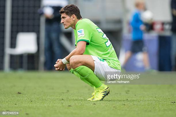 Mario Gomez of Wolfsburg reacts after the Bundesliga match between TSG 1899 Hoffenheim and VfL Wolfsburg at Wirsol RheinNeckarArena on September 17...