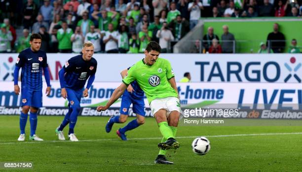 Mario Gomez of Wolfsburg scores his team's opening goal during the Bundesliga Playoff first leg match between VfL Wolfsburg and Eintracht...