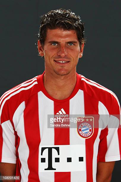 Mario Gomez poses during the FC Bayern Muenchen team presentation at Bayern's training ground Saebener Strasse on August 2 2010 in Munich Germany