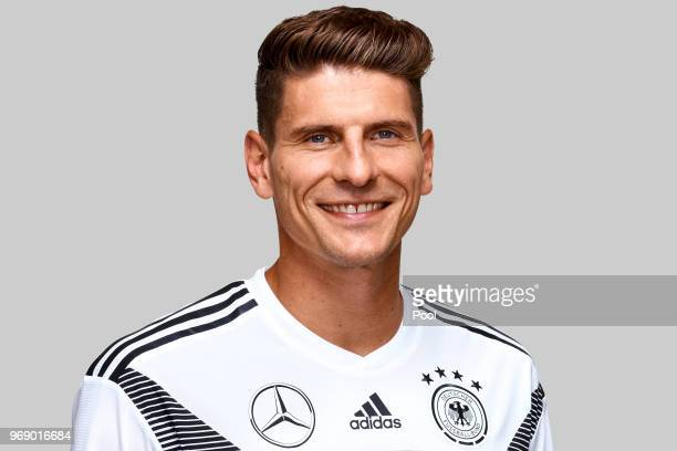 Mario Gomez poses for a photo during a portrait session ahead of the 2018 FIFA World Cup Russia at Eppan training ground on June 5 2018 in Eppan Italy