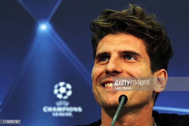 Mario Gomez smiles during a Bayern Muenchen press conference ahead of the UEFA Champions League Round of 16 second leg match against Inter Milan at...