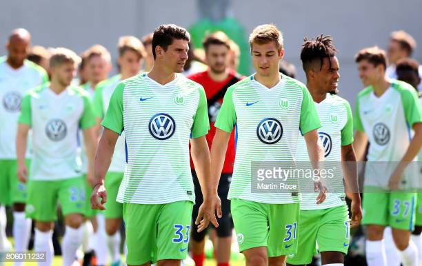 Mario Gomez talks to team mate Robin Knoche during a training session at Volkswagen Arena on July 3 2017 in Wolfsburg Germany