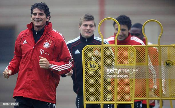 Mario Gomez Toni Kroos Mark van Bommel and Edson Braafheid exercise during the FC Bayern Muenchen training session at Bayern's training ground...