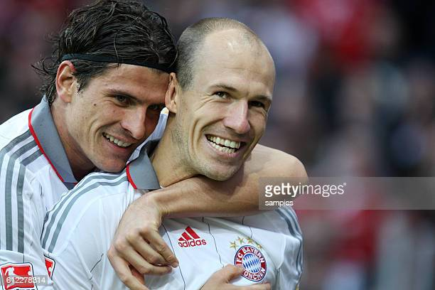 Mario Gomez with Arjen Robben after he scored to make it 01