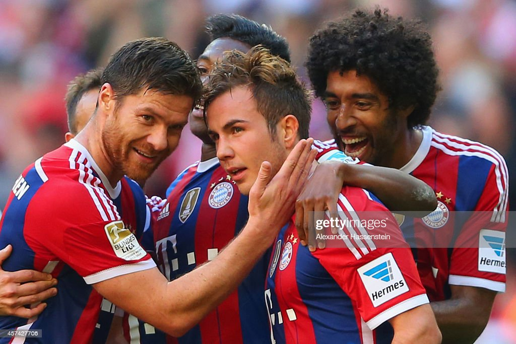 Mario Gotze of Bayern Muenchen celebrates scoring their fourth goal with team mates during the Bundesliga match between FC Bayern Muenchen and SV Werder Bremen at Allianz Arena on October 18, 2014 in Munich, Germany.