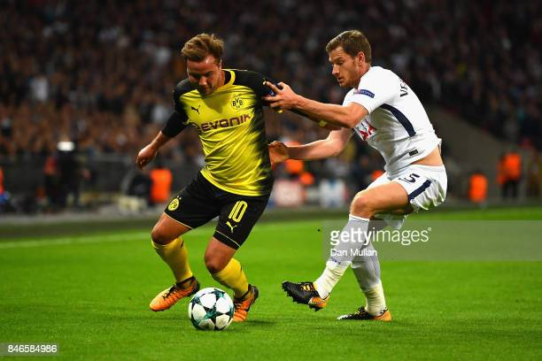 Mario Gotze of Borussia Dortmund and Jan Vertonghen of Tottenham Hotspur battle for possession during the UEFA Champions League group H match between...