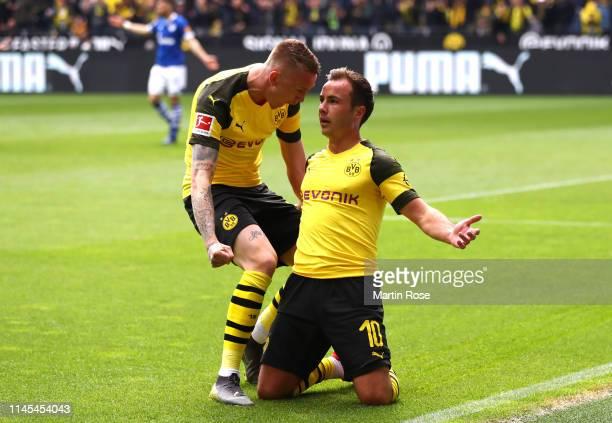 Mario Gotze of Borussia Dortmund celebrates after scoring his team's first goal with Marius Wolf during the Bundesliga match between Borussia...