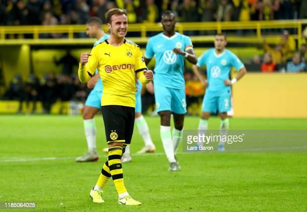 Mario Gotze of Borussia Dortmund celebrates after scoring his team's third goal during the Bundesliga match between Borussia Dortmund and VfL...
