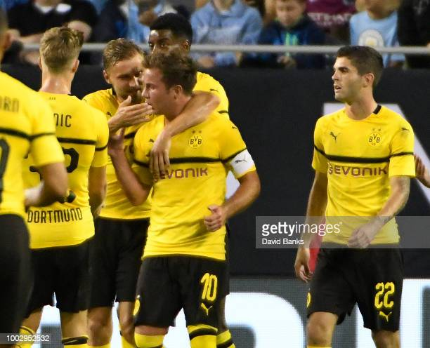 Mario Gotze of Borussia Dortmund celebrates his goal against Manchester City with his teammates on July 20 2018 at Soldier Field in Chicago Illinois