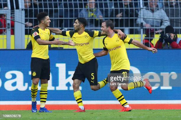 Mario Gotze of Borussia Dortmund celebrates with teammates Achraf Hakimi and Jadon Sancho after scoring his team's second goal during the Bundesliga...