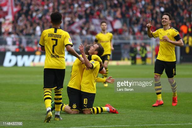 Mario Gotze of Borussia Dortmund celebrates with teammates after scoring his team's third goal during the Bundesliga match between Borussia Dortmund...