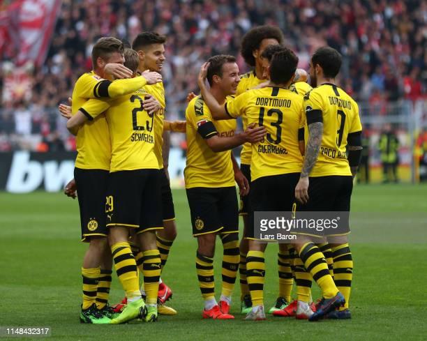 Mario Gotze of Borussia Dortmund celebrates with teammates after scoring his team's third goal during the Bundesliga match between Borussia Dortmund...