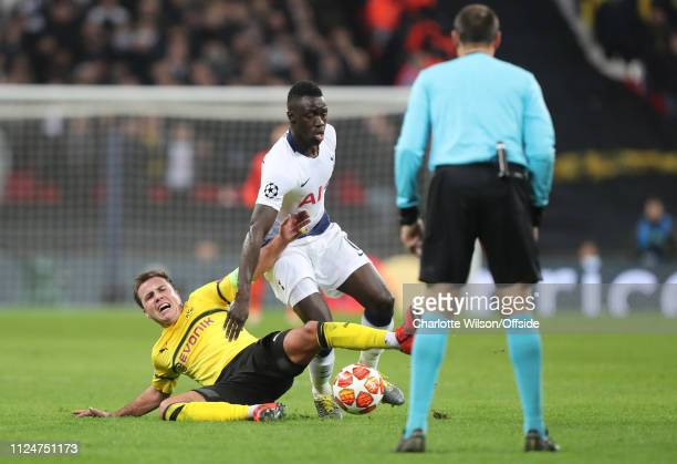 Mario Gotze of Borussia Dortmund looks to referee Antonio Mateu Lahoz as he goes down under pressure from Davinson Sanchez of Tottenham during the...