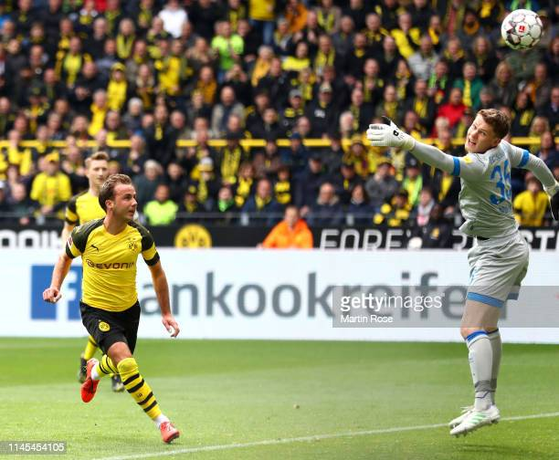 Mario Gotze of Borussia Dortmund scores his team's first goal past Alexander Nueebel of FC Schalke 04 during the Bundesliga match between Borussia...