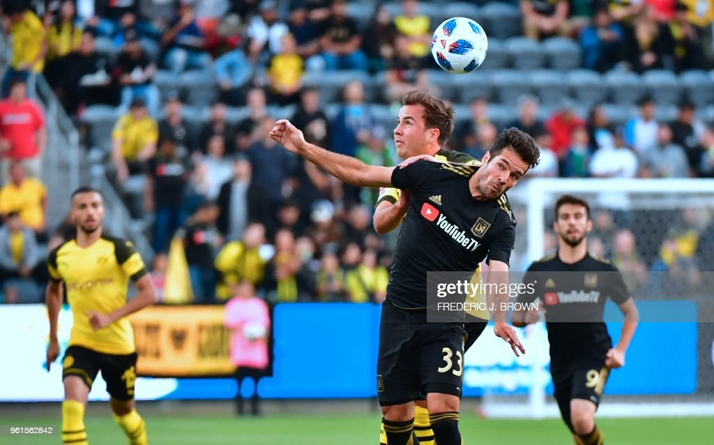 Mario Gotze (L)of Borussia Dortmund vies for the ball with Julian Weigl (R/#33) of LAFC (Los Angeles Football Club) during their international soccer friendly in Los Angeles, California on May 22, 2018. - The game ended in a 1-1 draw.