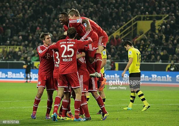 Mario Gotze of FCBayern is congratulated after scoring a goal during the Bundesliga match between FC Bayern and Bor Dortmund Signal Iduna Park on...