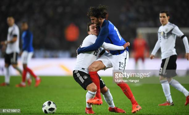 Mario Gotze of Germany and Adrien Rabiot of France battle for possession during the international friendly match between Germany and France at...