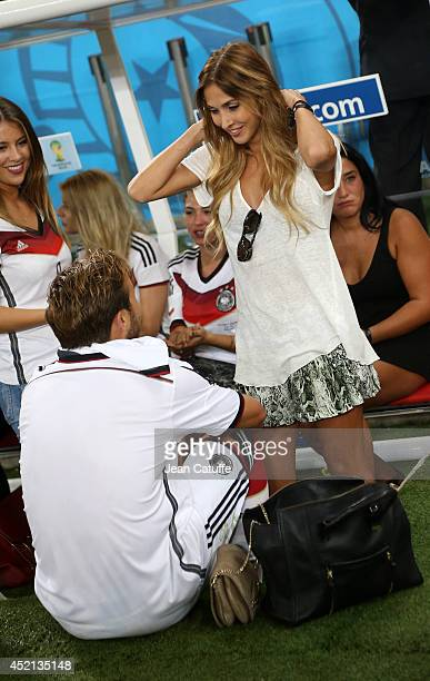 Mario Gotze of Germany and his girlfriend Ann-Kathrin Brommel celebrate the victory after the 2014 FIFA World Cup Brazil Final match between Germany...