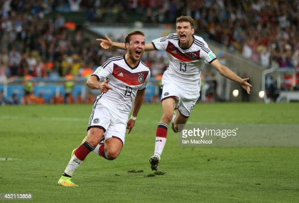 Mario Gotze of Germany celebrates after he scores during the 2014 World Cup final match between Germany and Argentina at The Maracana Stadium on July...