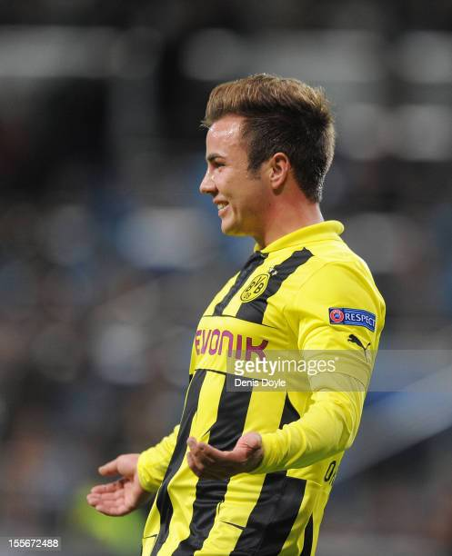 Mario Gotze of of Borussia Dortmund celebrates after scoring his team's second goal during the UEFA Champions League Group D match between Real...