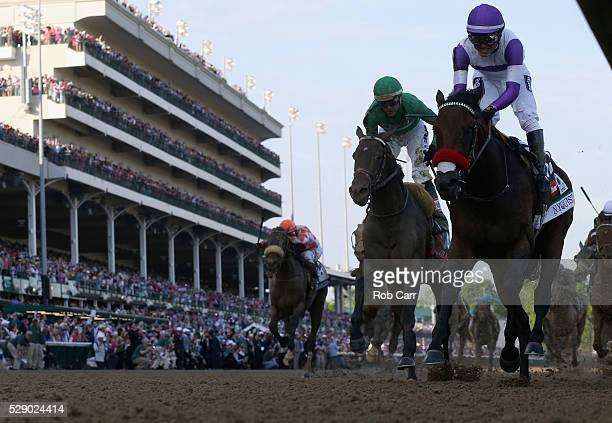 Mario Gutierrez celebreates atop Nyquist after crossing the finish line to win the 142nd running of the Kentucky Derby at Churchill Downs on May 07...