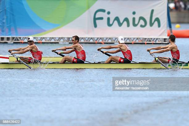 Mario Gyr Simon Niepmann Simon Schuerch and Lucas Tramer of Switzerland compete in the Lightweight Men's Four Final A on Day 6 of the Rio 2016...