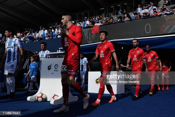 Mario Hermoso and his teammates Wu Lei , Sergi Darder and Naldo Gomes access to the pitch prior to start the La Liga match between CD Leganes and RCD...