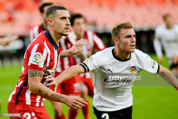 Mario Hermoso of Atletico and Toni Lato of Valencia in action during the Spanish La Liga football match between Valencia and Atletico de Madrid at...