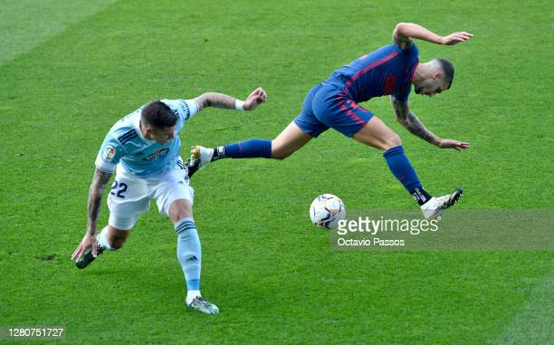Mario Hermoso of Atletico de Madrid battles for possession with Santi Mina of RC Celta during the La Liga Santander match between RC Celta and...