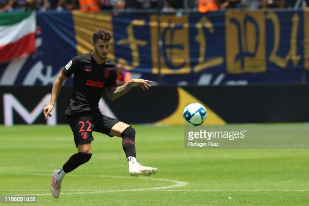 Mario Hermoso of Atletico de Madrid drives the ball during the friendly match between Atletico San Luis and Atletico de Madrid at Estadio Alfonso...