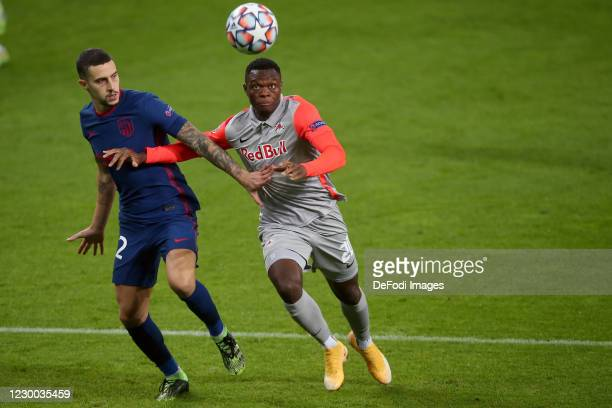 Mario Hermoso of Atletico Madrid and Patson Daka of Red Bull Salzburg battle for the ball during the UEFA Champions League Group A stage match...