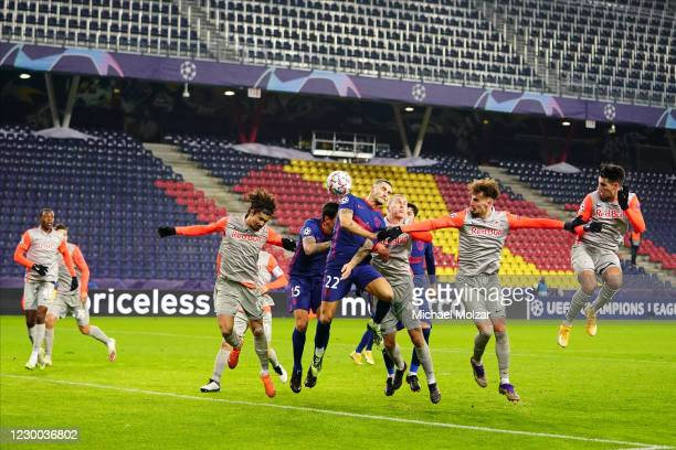 Mario Hermoso of Atletico Madrid scores by a header attacked by Andre Ramalho of Salzburg, Rasmus Kristensen of Salzburg, Mergim Berisha of Salzburg...